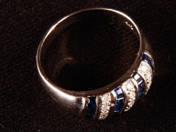 Arany gyűrű zafírokkal, brillel