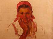 Piros kendős nő