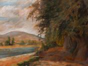 Napsütötte folyópart