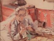 Ágyban olvasó nő