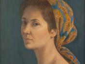 Fejkendős hölgy