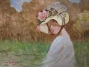 Hölgy virágos kalapban